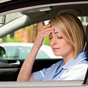 Woman in car with headache copyright Getty Images, Jupiter Images, Getty