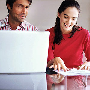 Couple with laptop copyright Image Source, SuperStock