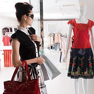 Young woman clothes shopping copyright Image Source, Getty Images
