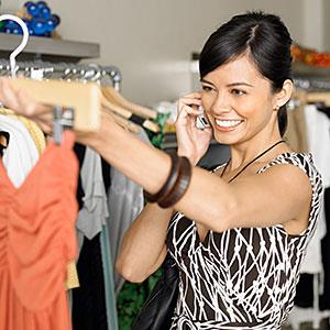 Image, Young woman shopping in boutique while on phone copyright Siri Stafford, Digital Vision, Getty Images