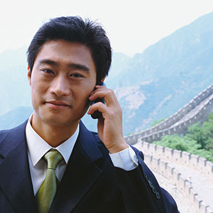 Businessman in China copyright Brooklyn Production, Corbis