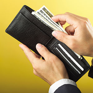Wallet with money copyright Creatas Images, Jupiterimages