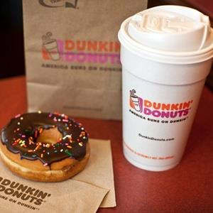 Chocolate donut & cup of coffee at a Dunkin' Donuts in West Orange, NJ, on July 7, 2011 (©Emile Wamsteker/Bloomberg via Getty Images)