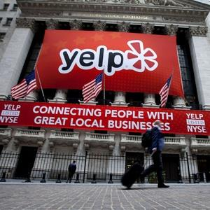 Yelp Inc. signage hangs outside of the New York Stock Exchange in New York on March 2, 2012 (© Jin Lee/Bloomberg via Getty Images)