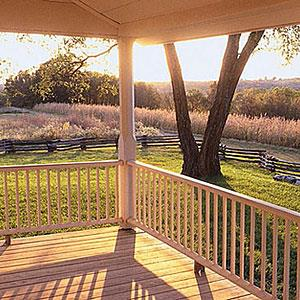 Image: Sunny Porch Overlooking a Lawn © Corbis, SuperStock