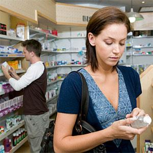 Woman looking at products in a pharmacy copyright B2M Productions, Photographer