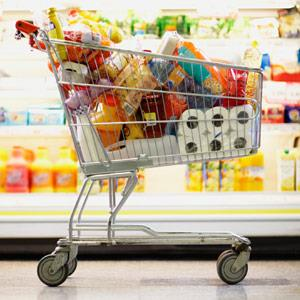 Full Shopping Cart in Grocery Store © Fuse Getty Images