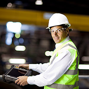 Engineer with handheld computer © Image Source Getty Images