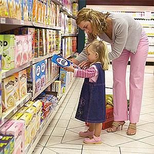 Girl grocery shopping with her mother copyright image100, SuperStock