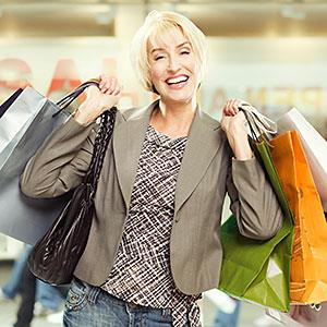 Woman in mall with shopping bags copyright Paul Bradbury, OJO Images, Getty Images