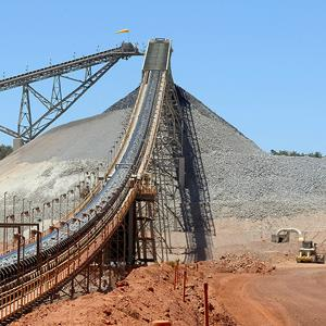 The primary conveyor belt transports crushed rock to the first stage of the gold separation process at Newmont Mining Corp.'s Boddington Gold mine, in Boddington, Western Australia