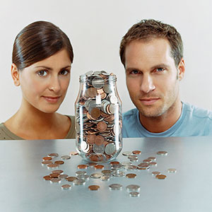 Image: Couple and cash (© Digital Vision Ltd./SuperStock)