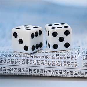 Dice on newspaper stock pages copyright Tom Grill, Photographer