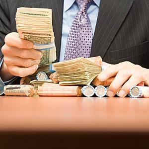 Businessman holding money copyright Image Source, Getty Images