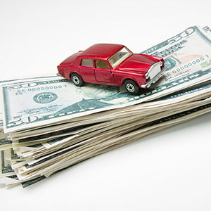 Car on stack of money © Dynamic Graphics Jupiterimages