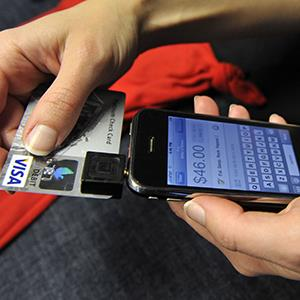 Willo O'Brien demonstrates a Square payment on her iPhone in San Francisco on Dec. 18, 2009 (© Russel A. Daniels/AP Photo)