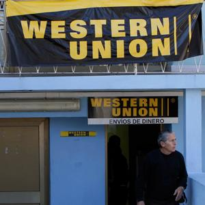 © Franklin Reyes/AP A man leaves a WesternUnion agency in Havana, Cuba