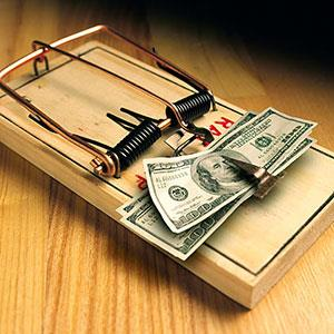 Image: Mouse trap with money (© Ingram Publishing/SuperStock)