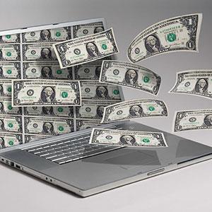 Image: Money and computer © Angel Muniz Jupiterimages