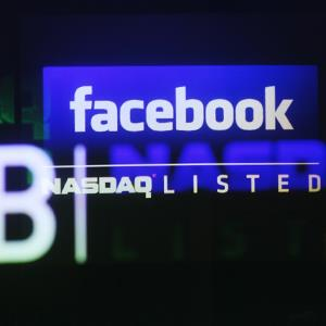 File photo of the Facebook logo on a screen inside the Nasdaq Marketsite in New York ( Shannon Stapleton/Newscom/Reuters)&#10;