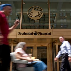 Pedestrians pass the headquarters building of Prudential Financial Inc. in Newark, New Jersey
