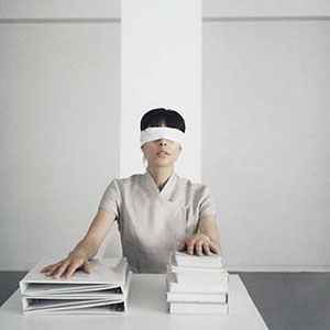 Image: Blindfolded woman ( PhotoAlto/Jupiterimages)