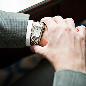Image: Man in suit checking watch © Daniel Sheehan Photographers, Digital Vision, Getty Images