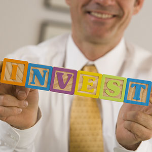 Investment building blocks copyright Comstock Images, Jupiterimages
