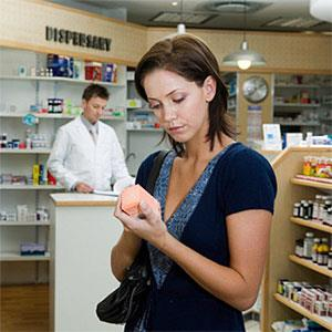Young woman looking at medicine in pharmacy, close-up copyright B2M Productions, Digital Vision, Getty Images