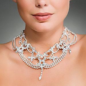 Image: Woman wearing a diamond necklace © Image Source, Corbis
