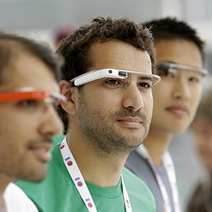 Google Glass team members wear Google Glasses at a booth at Google I/O 2013 in San Francisco, Calif. on May 15, 2013 (© Jeff Chiu/AP Photo)