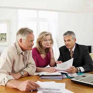 Couple with financial planner copyright moodboard, Corbis