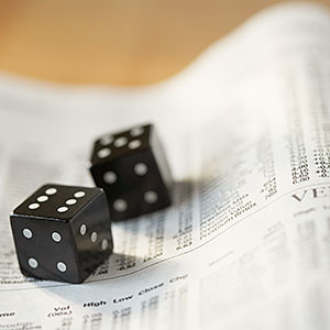 Image: Dice on stock listings (© Kate Kunz/Corbis)