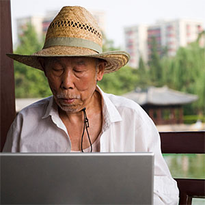 Man with laptop copyright Mike Kemp, Getty Images, Getty Images
