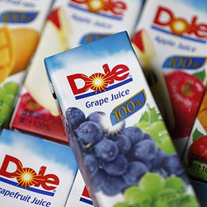 File photo of cartons of Dole Food Co. fruit juice (© Kiyoshi Ota/Bloomberg via Getty Images)