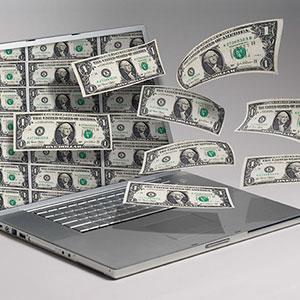 Money and computer copyright Angel Muniz, Jupiterimages