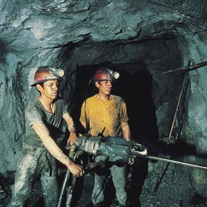 Coal miners (© Digital Vision/SuperStock)