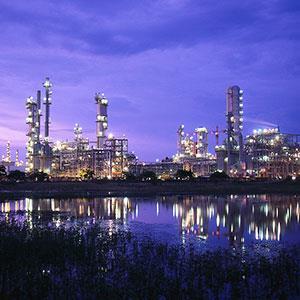 Oil refinery (© Kevin Burke/Corbis)