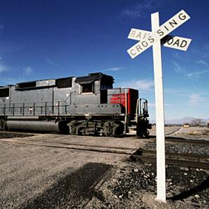 Railroad Crossing with Train (© Edmond Van Hoorick/Photodisc/Getty Images)