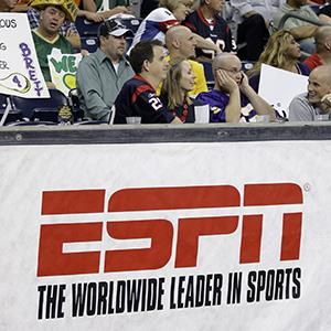 An ESPN sign is shown during a preseason NFL football game at Reliant Park in Houston, Texas (© David J. Phillip/AP Photo)