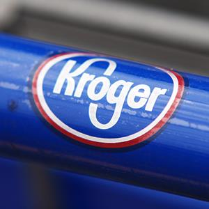 Kroger logo on a grocery cart (© Brian Christopher/Demotix/Demotix/Corbis)