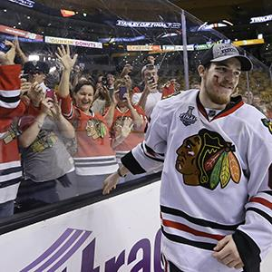 Chicago Blackhawks center Andrew Shaw skates from the glass after celebrating with fans in Game 6 of the NHL hockey Stanley Cup Finals on June 24, 2013 in Boston (© Elise Amendola/AP Photo)