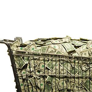 Shopping cart full of cash copyright RubberBall, SuperStock
