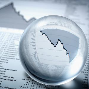 Crystal ball on descending stock graph (© Adam Gault/OJO Images/Getty Images)