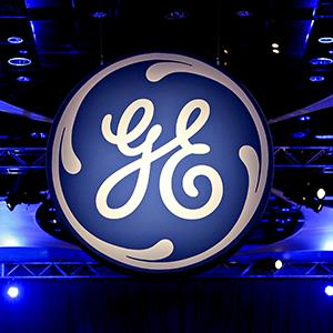 The General Electric Co. logo is displayed during the company's 2010 annual meeting in Houston, Texas (© Aaron M. Sprecher/Bloomberg via Getty Images)