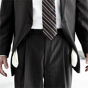 Businessman with empty pockets © Image Source, Image Source, Getty Images
