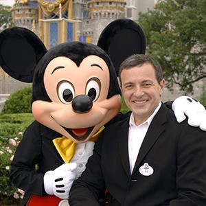 Bob Iger with Mickey Mouse © Gene Duncan/Disney/AP Photo