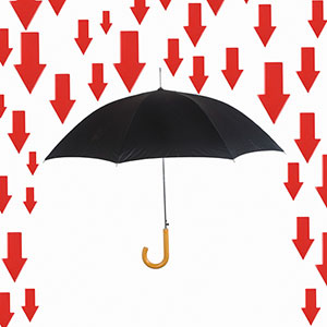 Arrows rain down on umbrella (copyright Photographers Choice RF/SuperStock)