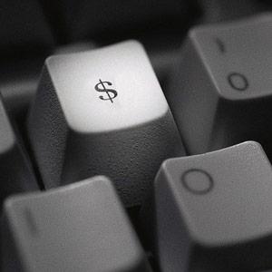Dollar sign on keyboard © Corbis