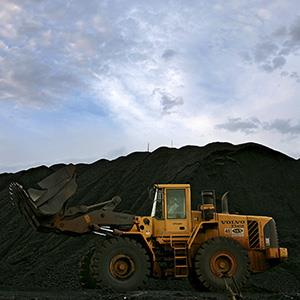 A bulldozer picks up vegetal coal at an aluminum plant expansion area of Brazil's mining company Vale, in Barcarena, some 110 km southwest from Para's northern capital of Belem, Brazil, on August 14, 2008. (© Mauricio Lima/AFP/Getty Images)